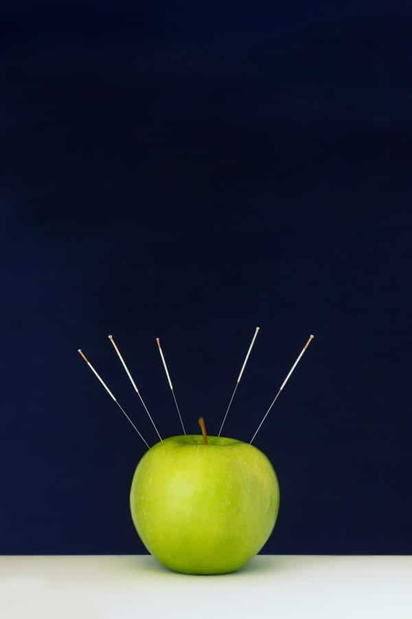 Acupuncture Needles Stuck Into A Green Apple As A Symbol Emperors